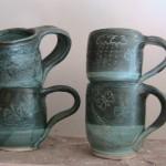 Stoneware medium mug everglade and slip decoration oxidation fired